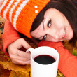 Girl in autumn orange leaves with cup coffe. — Stock Photo #6725246