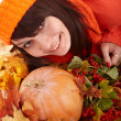 Girl with pumpkin on autumn leaves. — Stock Photo #6725250