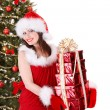 Christmas girl in santa holding stack gift box. - Stock Photo