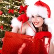 Christmas  shopping of girl in santa hat, fir tree. — Stock Photo