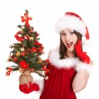 Christmas girl in santa hat with small tree in hand. — Stock Photo #6725352