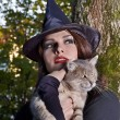 Witch holding cat outdoor. — Stock Photo #6725427