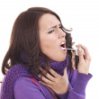 Woman using throat spray. — Stock Photo