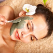 Young woman having clay body mask. — Stock Photo #6725646