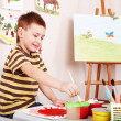 Child paint picture in preschool. — Stock Photo #6725669