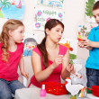 Children with teacher in play room. — Stock Photo #6725675