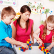Child with wood block  in play room. - Stock Photo
