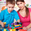 Child playing  lego  block with mother at home. — Stock Photo