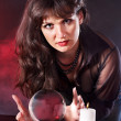 Young woman  with crystal ball. - Foto Stock