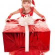 Child in santa hat holding red gift box. — Stock Photo #6725810