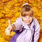 Kid in autumn orange leaves. — Stock Photo #6725884