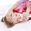 Sick child with handkerchief in bed. — Stock Photo #6725918