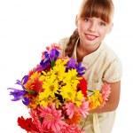 Happy child holding flowers. — Stock Photo #6725932
