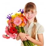 Happy child holding flowers. — Stock Photo #6725934