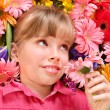 Child lying on the flowers. — Stock Photo #6725938