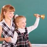 Schoolchildren in classroom near blackboard. — Stock Photo #6725939