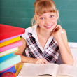 Schoolchild in classroom near blackboard. — Stock Photo #6725953