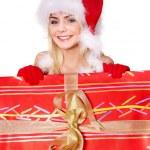 Girl in santa hat holding gift box . — Stock Photo #6726277