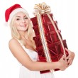 Christmas girl in santa hat holding stack gift box. — Stock Photo #6726321