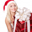 Christmas girl in santa hat holding stack gift box. — Stock Photo #6726330