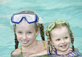 Children swim in swimming pool. — Foto Stock