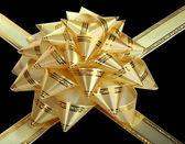 Zlatý luk a stuhou. samostatný. — Stock fotografie