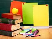Books and blackboard. School supplies. — Stock Photo