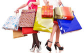 Shopping bag and group of leg in shoes. — Stock Photo