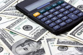 Calculator and dollars. — Stock Photo