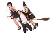 Girl witch on broom bear helpless man. — Stock Photo