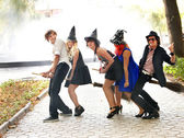 Group of in witck hat on broomstick. — Stock Photo
