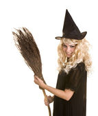 Halloween witch blond in black dress and hat with broom. — Stock Photo