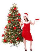Noel ağacı tarafından santa şapkalı kız. — Stok fotoğraf