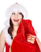 Kerstmis meisje in kerstmuts met een zak van heden. — Stockfoto