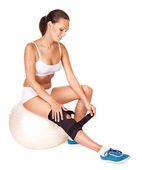 Woman with knee brace. — Stock Photo