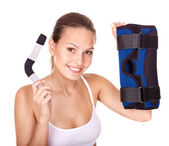 Woman holding hinged knee braces. — Stock Photo