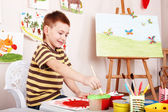 Child paint picture in preschool. — Stock fotografie
