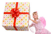 Girl and big gift box. — Stock Photo