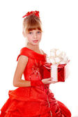 Girl child in red dress with gift box. — Stock Photo