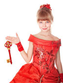 Child in long red dress holding christmas key,. — Stock Photo