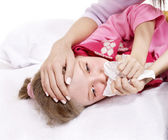Sick child with handkerchief in bed. — Stock Photo