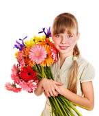 Happy child holding flowers. — Stock Photo