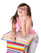 Girl with pile colored book . — Foto Stock