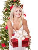 Beautiful girl giving red gift box. — Stock Photo
