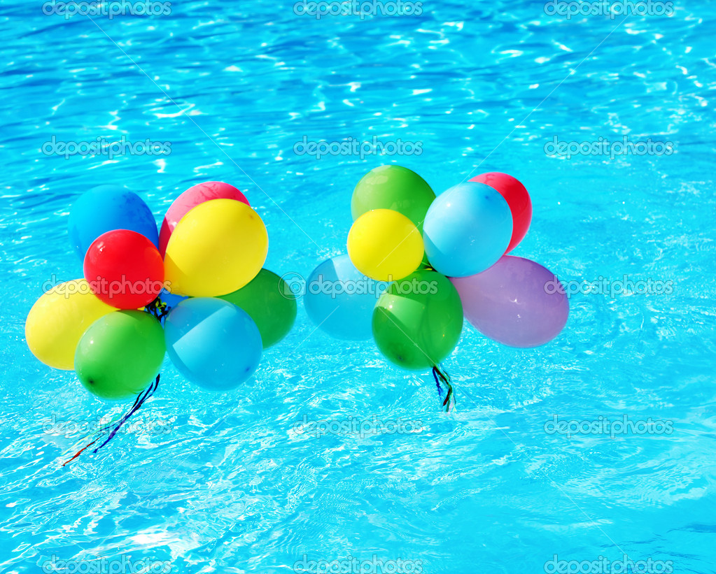 Balloons floating in swimming pool stock photo for Water balloon christmas decorations
