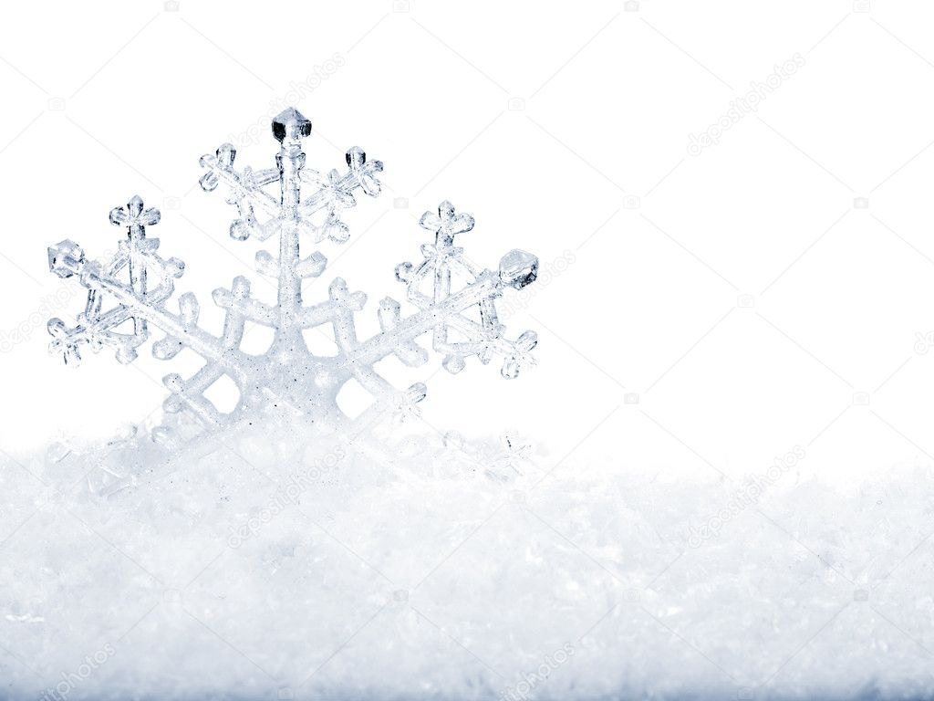 Snowflake in white snow. Isolated.  Stockfoto #6724161