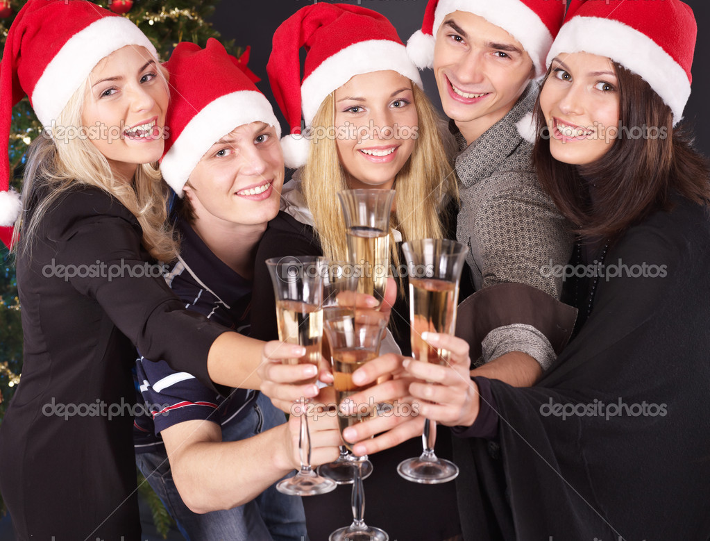 Group young in santa hat drinking champagne at nightclub. — Stock Photo #6724895