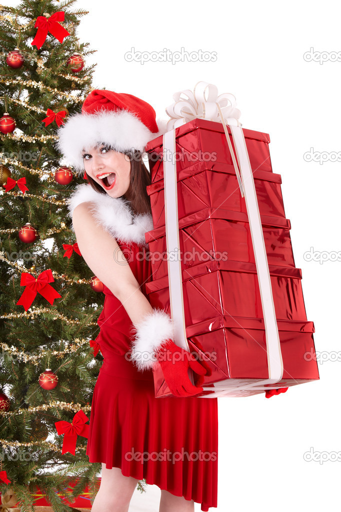 Girl in santa hat holding stack gift box near christmas tree.  Isolated. — Stock Photo #6725279