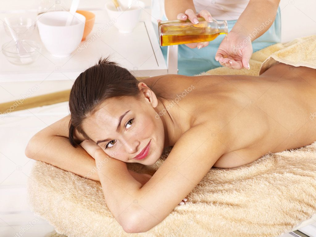Young woman having classical massage in beauty spa. Series.  Stock Photo #6725441