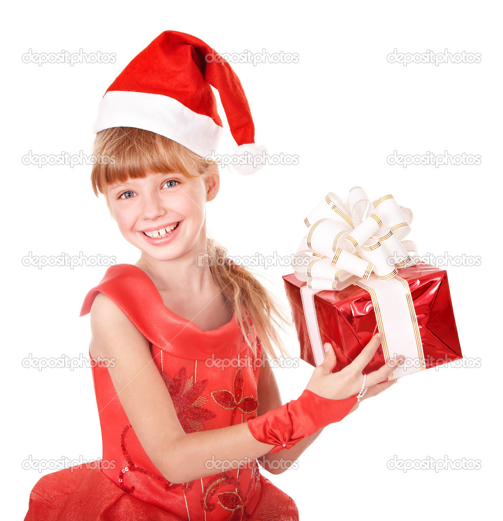 Little girl in santa hat holding red gift box.  Isolated. — Photo #6725808